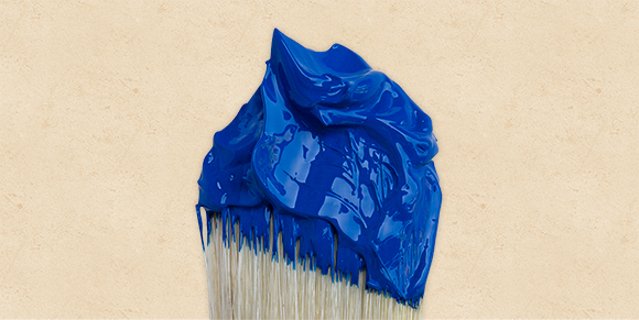 blue high viscosity paint on a paint brush