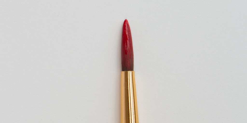 red paint on a brush