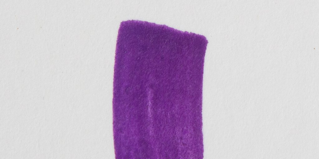 a purple paint marker stroke