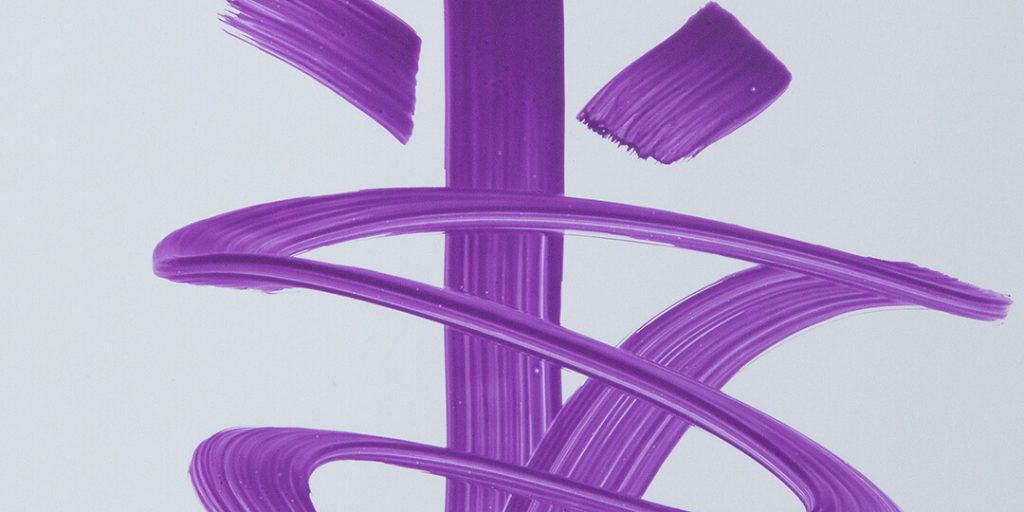 purple marker strokes on a glossy surface