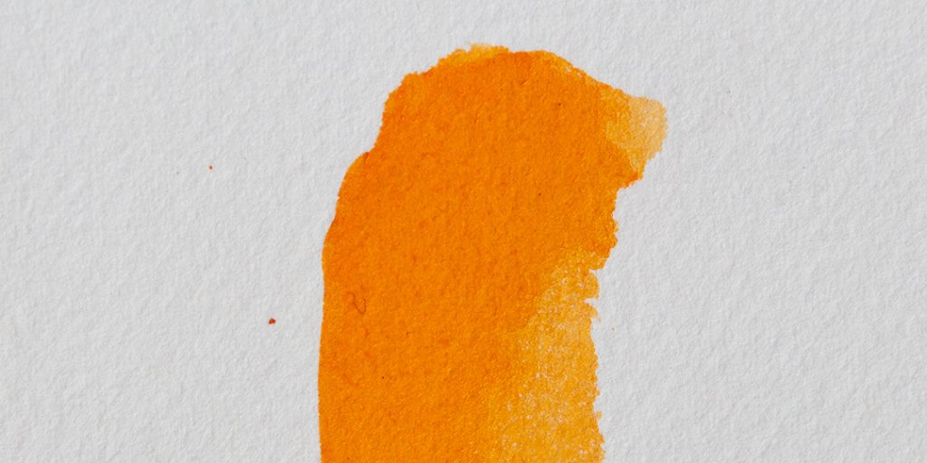 a swatch of orange watercolour paint