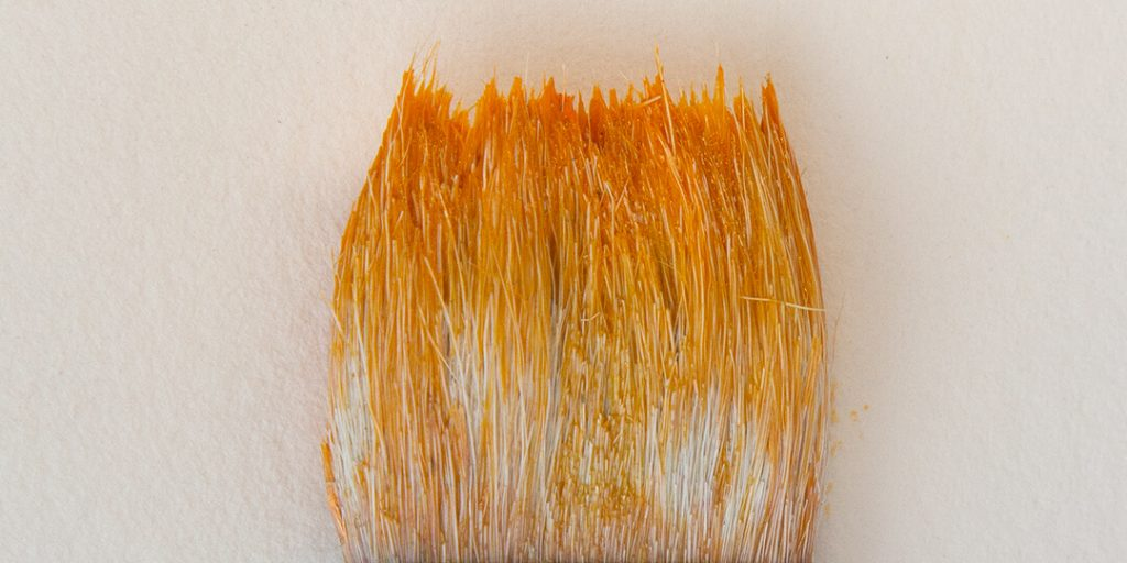 a paint brush stain orange from watercolours use