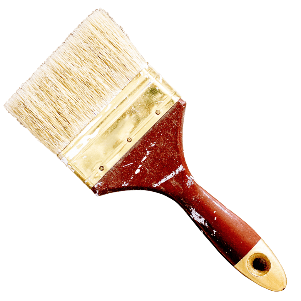a paint brush splattered with white paint