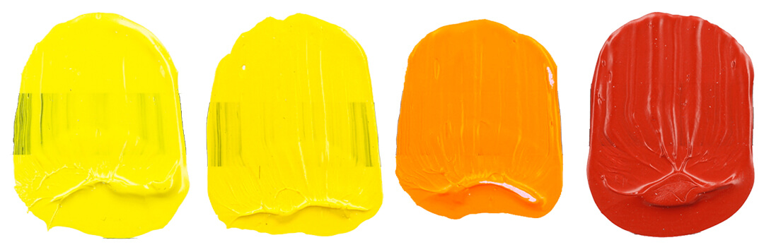 a row of cadmium paint swatches from yellow to red