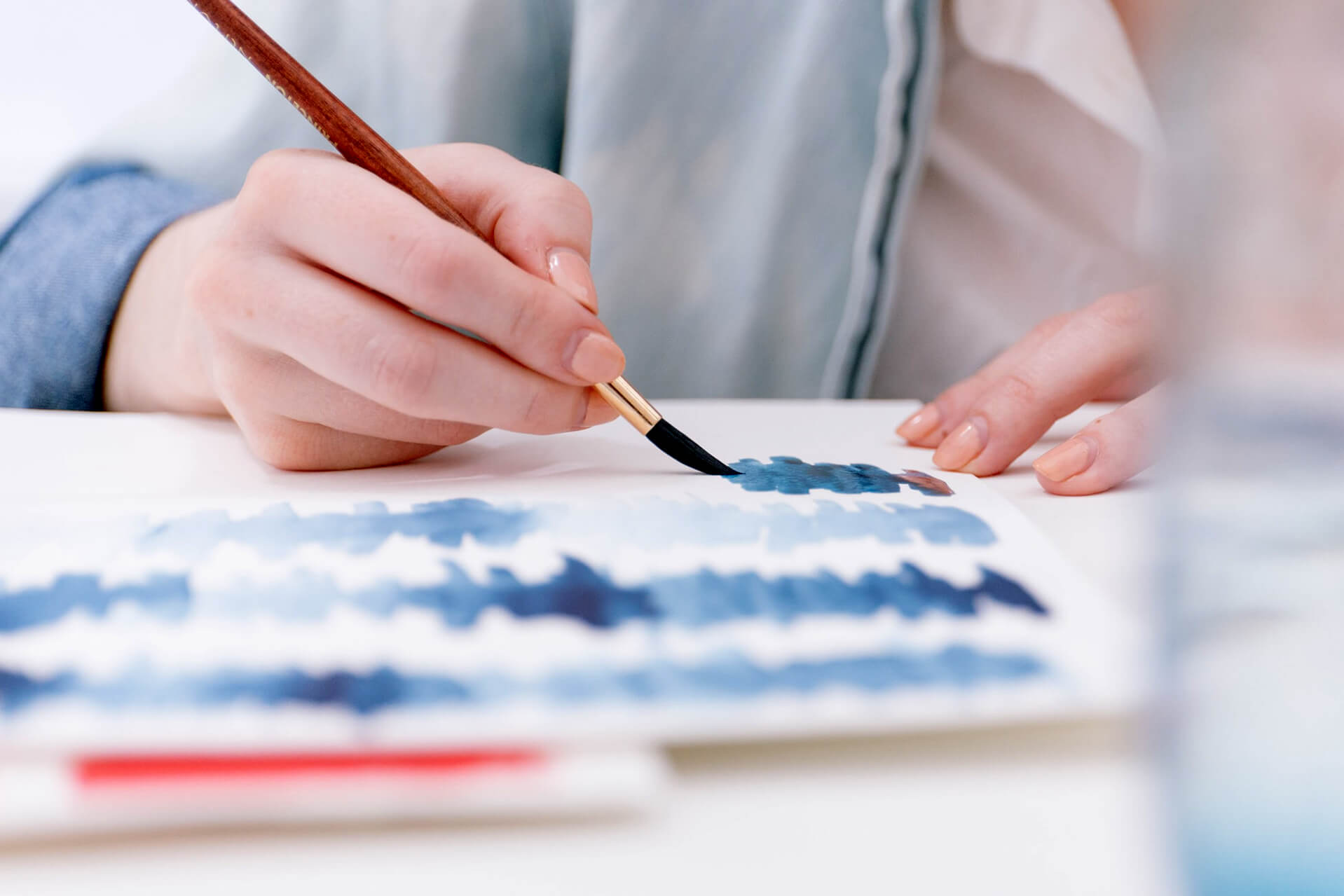 a painter making gradients with watercolour