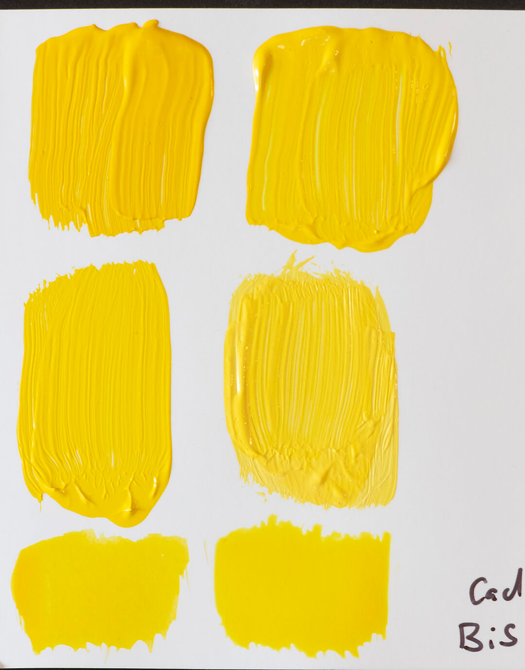 cadmium yellow swatches next to bismuth yellow swatches