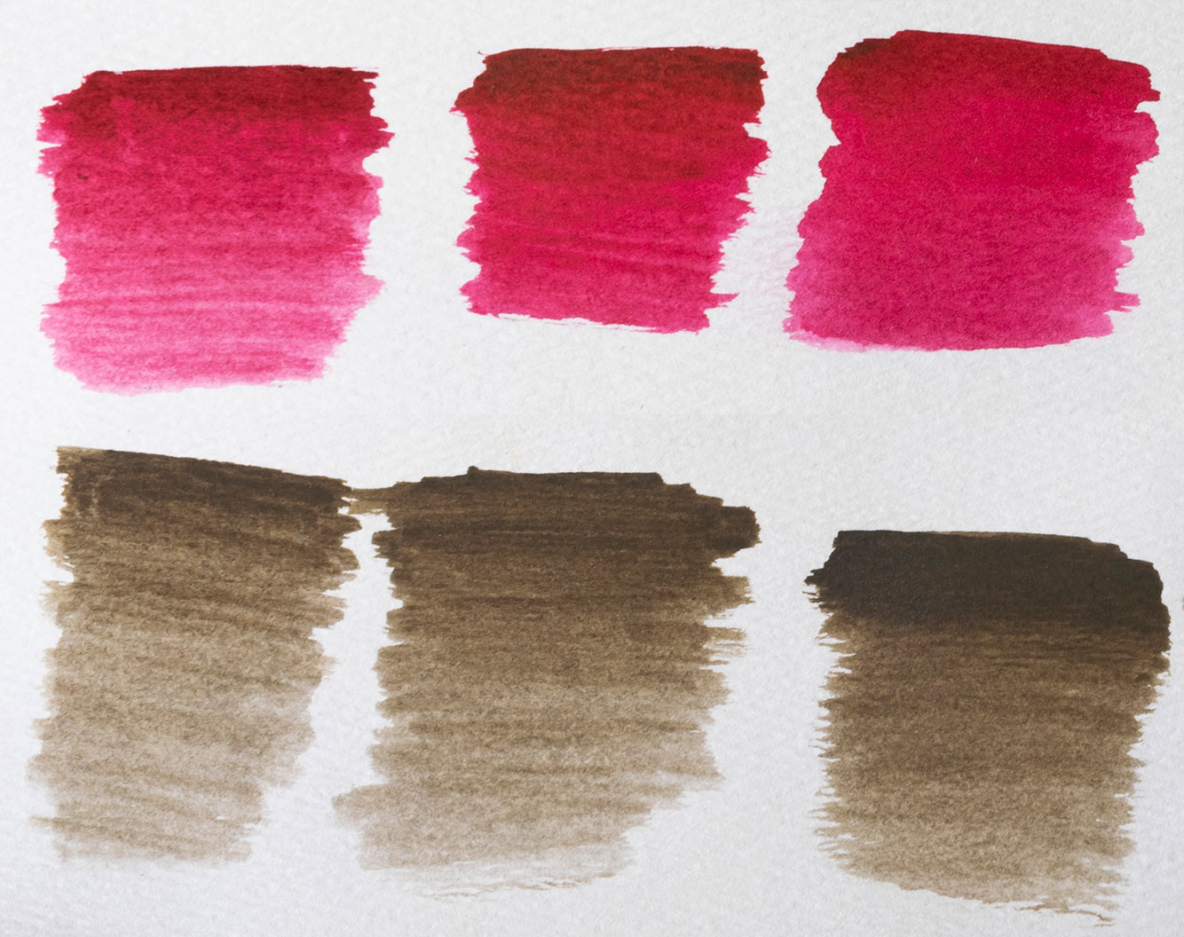 Paint outs of watercolours, both brown and red. Three samples each show the watercolour becoming more saturated and even in colour.