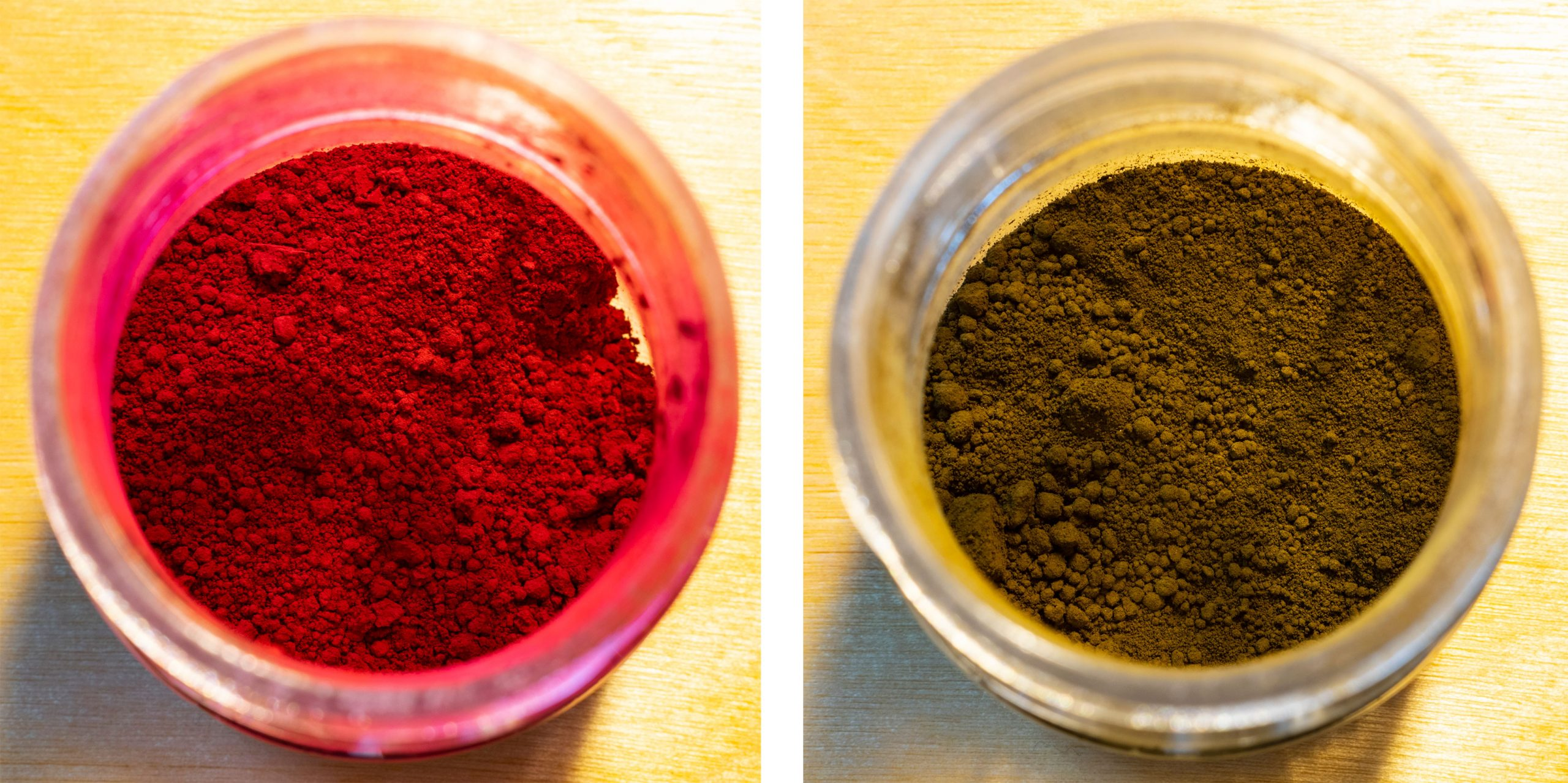 two containers of pigment, one red, one brown.