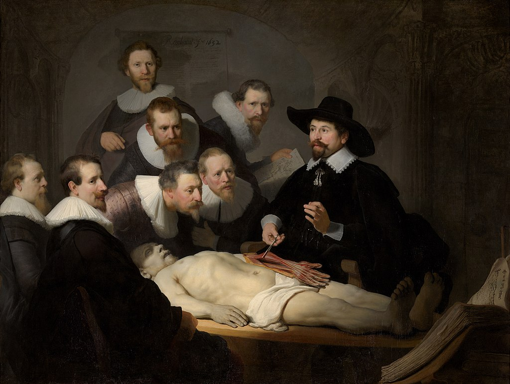 Painting by Rembrandt, the Anatomy Lesson. A group of students in Dutch 17th century garb watch closely as a man holds the dissected arm tendons of a corpse